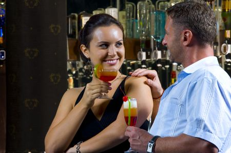 tonight: Portrait of young attractive couple having date in bar Stock Photo