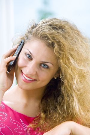 Portrait of young beautiful woman with mobile phone photo