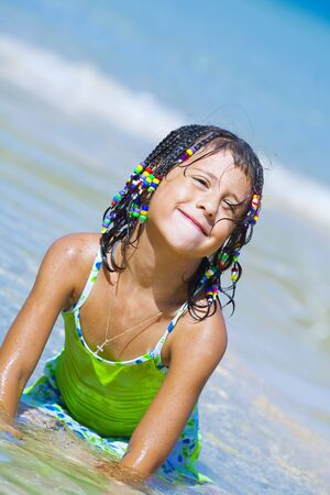 shallow water: Portrait of little girl having good time in summer environment
