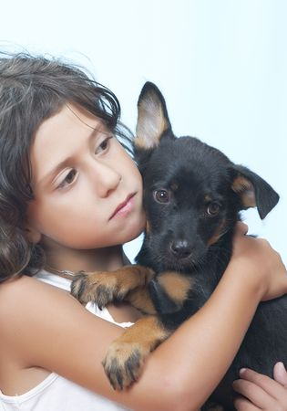 nursling: Portrait of little girl having good time with her puppy