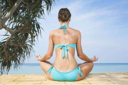 Portrait of young woman practicing yoga in summer environment Stock Photo - 4472354
