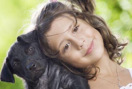 nursling: Portrait of little girl having good time in summer environment