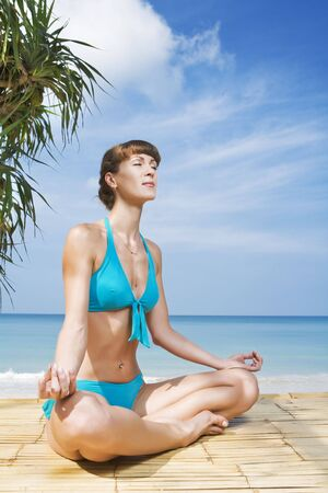 Portrait of young woman practicing yoga in summer environment Stock Photo - 4472400