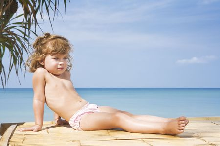 innocence: Portrait of nice little girl having fun on the beach