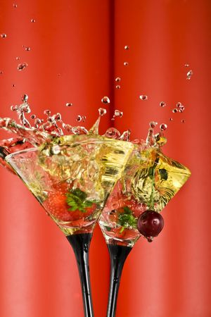 vermouth: view of  martini glass with vermouth and berry dropping in