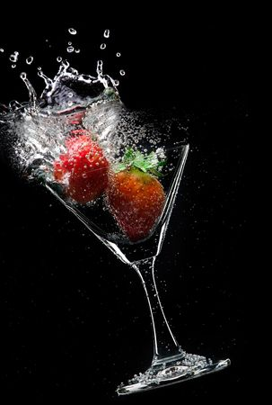 sweet vermouth: view of  martini glass with strawberry on black background
