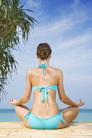 Portrait of young woman practicing yoga in summer environment Stock Photo - 4670712