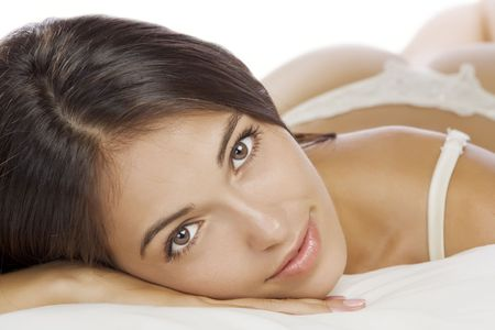 Portrait of young beautiful woman on white sheet Stock Photo - 4670713