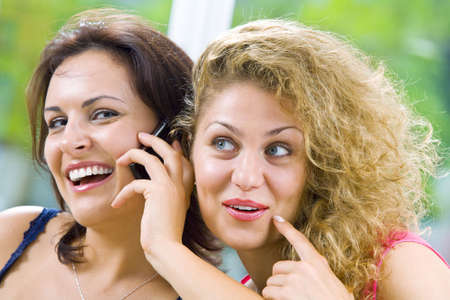 giggle: Portrait of two young attractive women in domestic environment