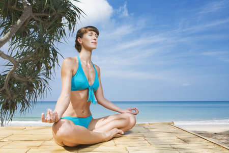 Portrait of young woman practicing yoga in summer environment Stock Photo - 4971028