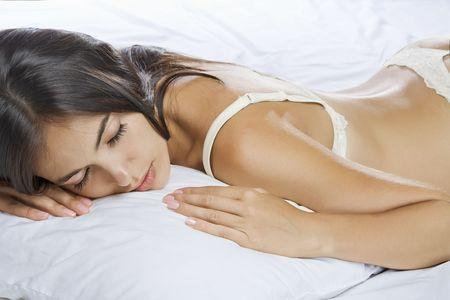 cushions: Portrait of young beautiful woman on white sheet