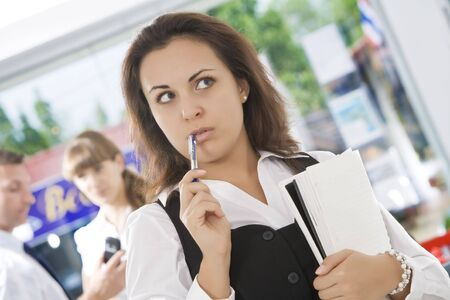 Portrait of young pretty woman in business environment Stock Photo
