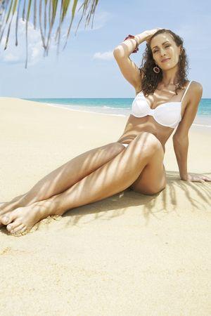 Portrait of beautiful girl having good time on tropical beach photo