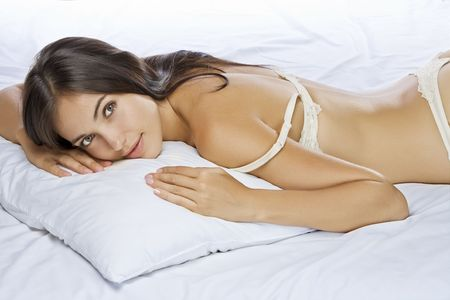 underwear girl: Portrait of young beautiful woman on white sheet