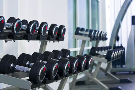 health clubs: Fragment like  view of gym interior  with some dumbbells