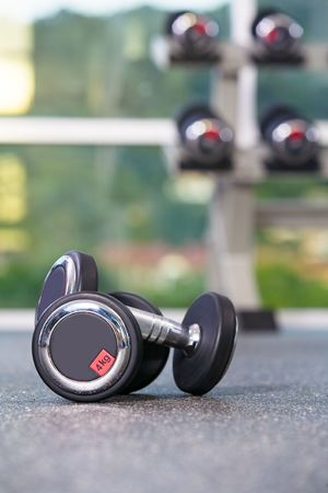 Fragment like  view of gym interior  with some dumbbells Stock Photo - 5294246