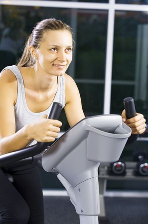Portrait of young woman  getting busy in gym     photo