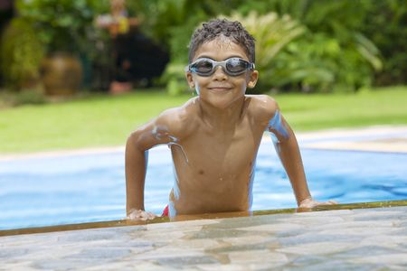 mulatto: Portrait of little boy  having good time in swimming pool