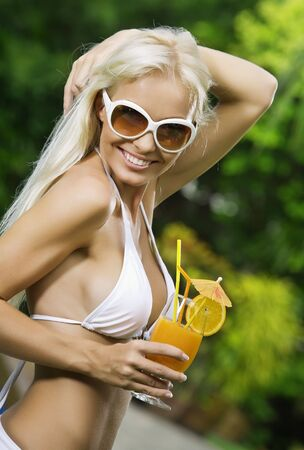 Portrait of young attractive woman having good time in tropic environment Stock Photo - 5509267