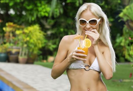 Portrait of young attractive woman having good time in tropic environment Stock Photo - 5509247