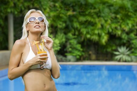 Portrait of young attractive woman having good time in tropic environment Stock Photo - 5509257