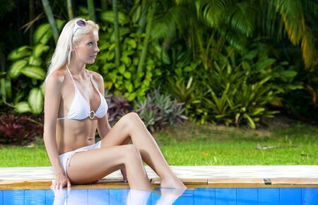 Portrait of young attractive woman having good time in tropic environment Stock Photo - 5509296
