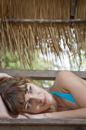 Portrait of beautiful girl having good time in tropical environment  photo