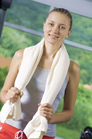 Portrait of young nice woman getting busy in gym Stock Photo - 5532204