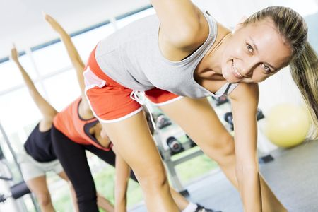 Portrait of young nice people  getting busy in gym Stock Photo - 5557305