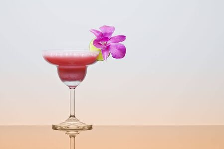 Close up view of nice fresh cocktail decorated with orchid photo