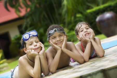 mulatto woman: Portrait of little kids having good time in summer environment Stock Photo