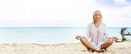 Portrait of young woman practicing yoga in summer environment Stock Photo - 5669288