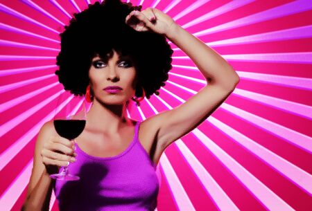 tempt: Pop art like image of young nice woman with glass of wine on pink back