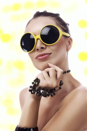 recollections: Portrait of  young gorgeous woman in funky yellow sunglasses