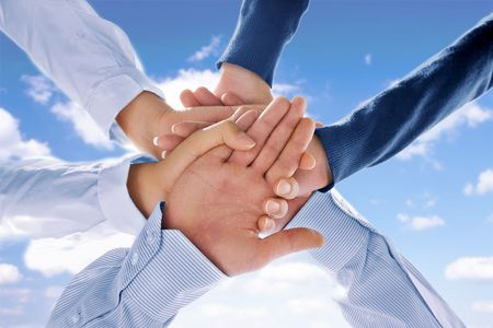 getting together: Close up view of hands getting together  on blue background Stock Photo