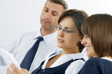 Portrait of young business people  discussing project in office environment photo