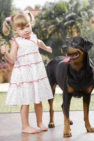 Portrait of little girl having good time  in summer environment photo