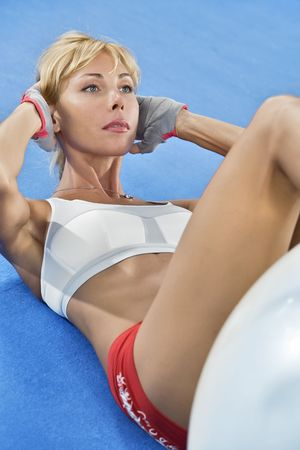 Portrait of young nice woman getting busy in gym Stock Photo - 6376171