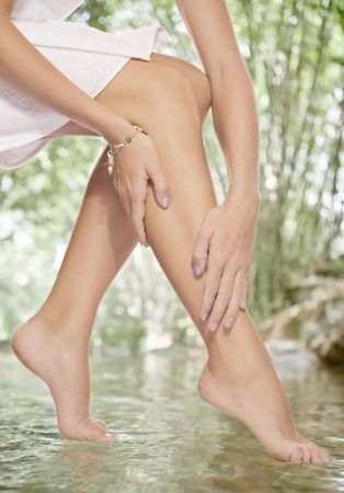 waxed legs: close up view of smooth woman�s legs in summer environment Stock Photo