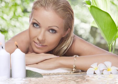 relax skin: portrait of young beautiful woman in spa environment