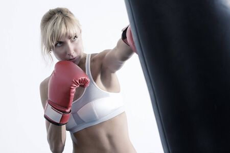 female boxer: Portrait of nice young woman having workout in gym