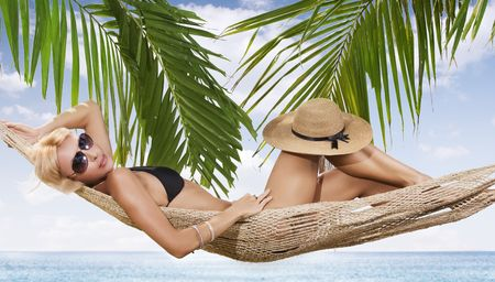 cerulean: view of nice woman lounging in hammock in tropical environment