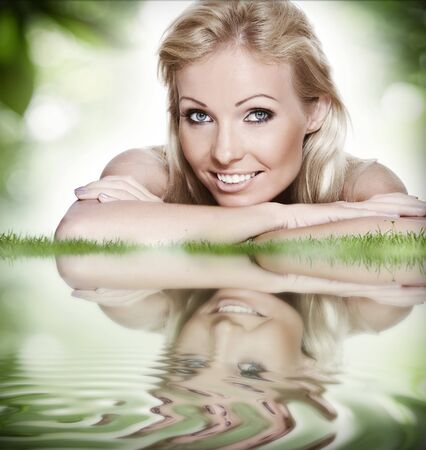 portrait of young beautiful woman  in summer environment  photo