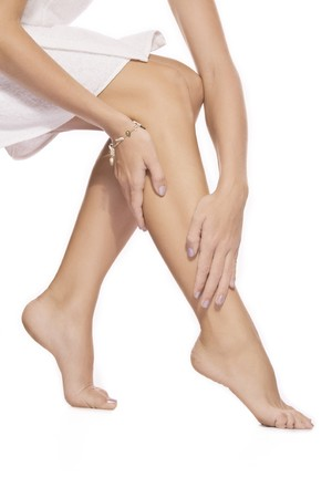 waxed: close up view of smooth woman�s legs on white background