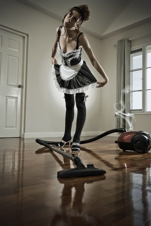 grungy look  funny portrait of housemaid  in domestic environment photo