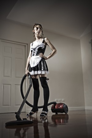 Portrait of nice young house maid in domestic environment