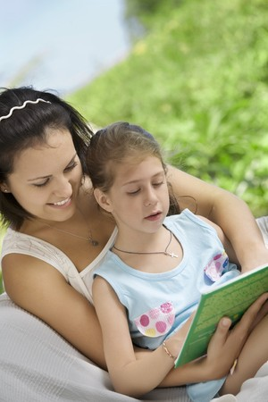 portrait of happy mother with daughter  having good time in summer environment Stock Photo - 7144711