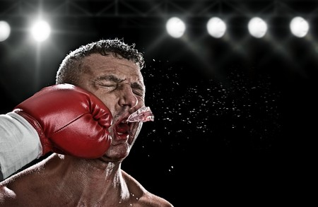 boxer: low key portrait of boxer getting knocked out