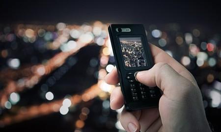 close up view of  mobile phone taking picture on color back Stock Photo - 7397090