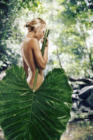 jungle girl: High key portrait of young beautiful woman  on clolr background
